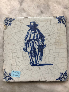 17 th century delft tile with man on horse