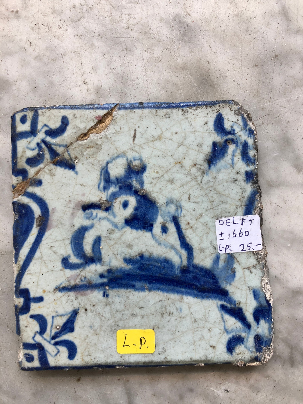 17 th century delft tile with dog