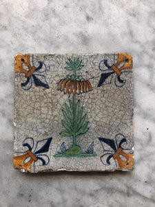 17 th century delft tile with flower