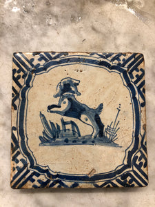 Early 17 th century delft tile with dog