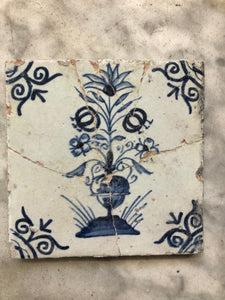 17 th century delft tile with flower vase