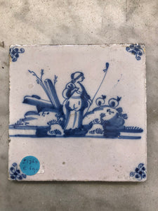 18 th century delft tile with shepherd lady