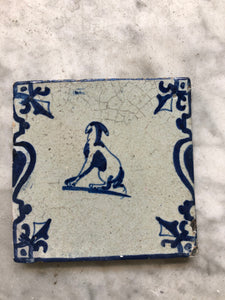 17 th century delft tile dog