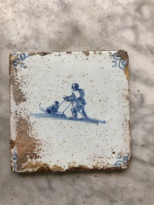 17 th century delft tile with skaters