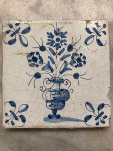17 th century delft tile with flowervase