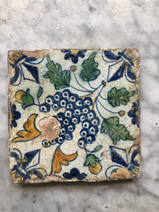 17 th century polychrome delft tile with grapes