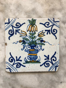 Nice early polychrome delft tile with flower vase