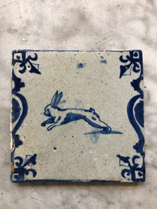17 th century delft tile with rabbit