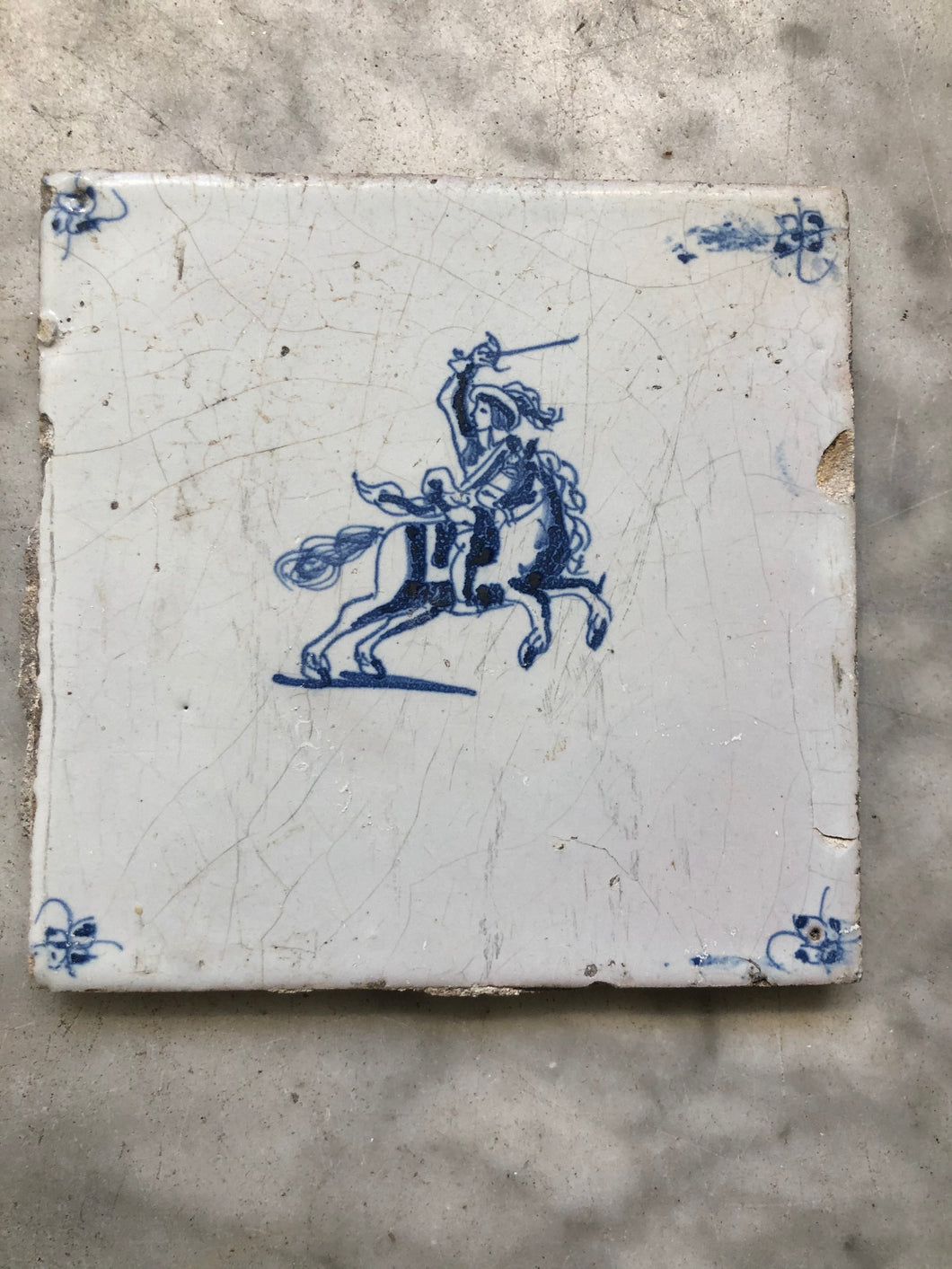 17 th century delft tile with horseman