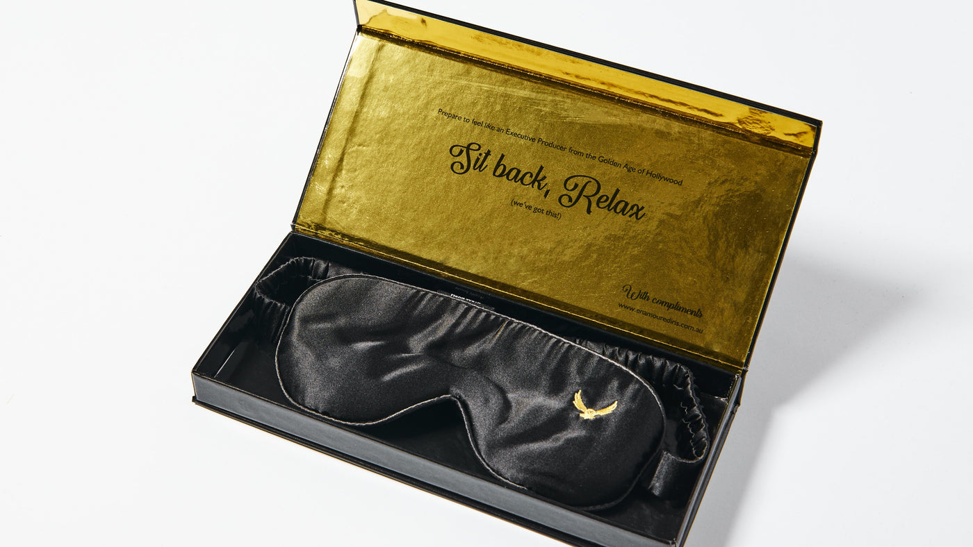 Enamoured Iris's luxurious silk eye mask in a gold box with custom engraving