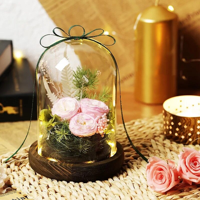 rose eternelle en verre sous cloche rose