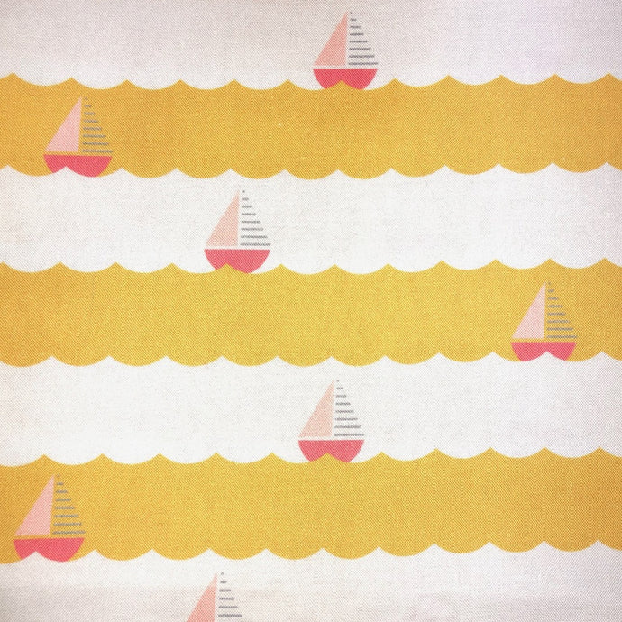 artisanal facemask 100% cotton handmade in Montreal  with pink sailboats on yellow waves by www.masqc.org