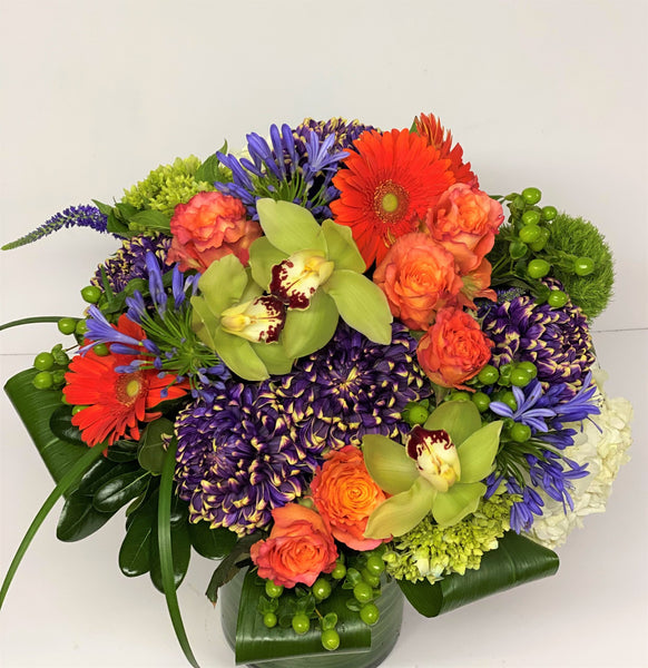 F31 - Vibrant Orange, Purple and White Vase Arrangement