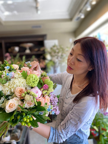 Designer Christine Liao with one of her fresh flower creations