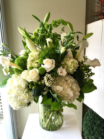 white fresh flower funeral vase arrangement
