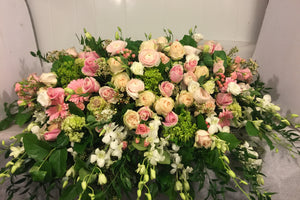 FNC8 - Pastel Closed Casket Arrangement - Flowerplustoronto