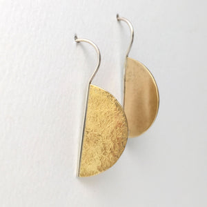 textured semi circle brass earrings  on attached sterling silver ear wire side view