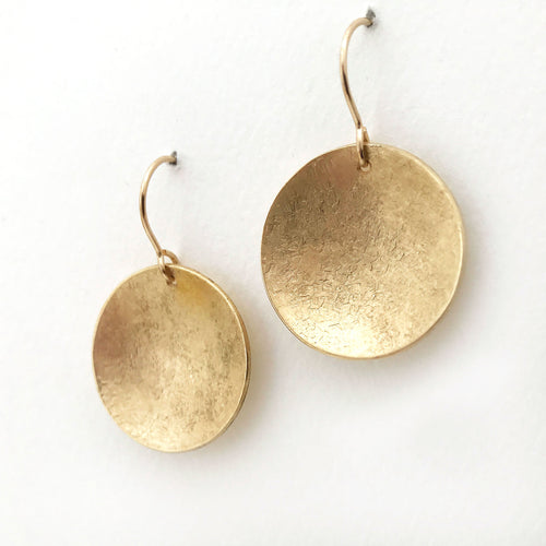 large textured brass earrings disc shape  matte finish side view