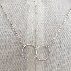 sterling silver necklace thin wire interlocking circles sterling cable chain on display