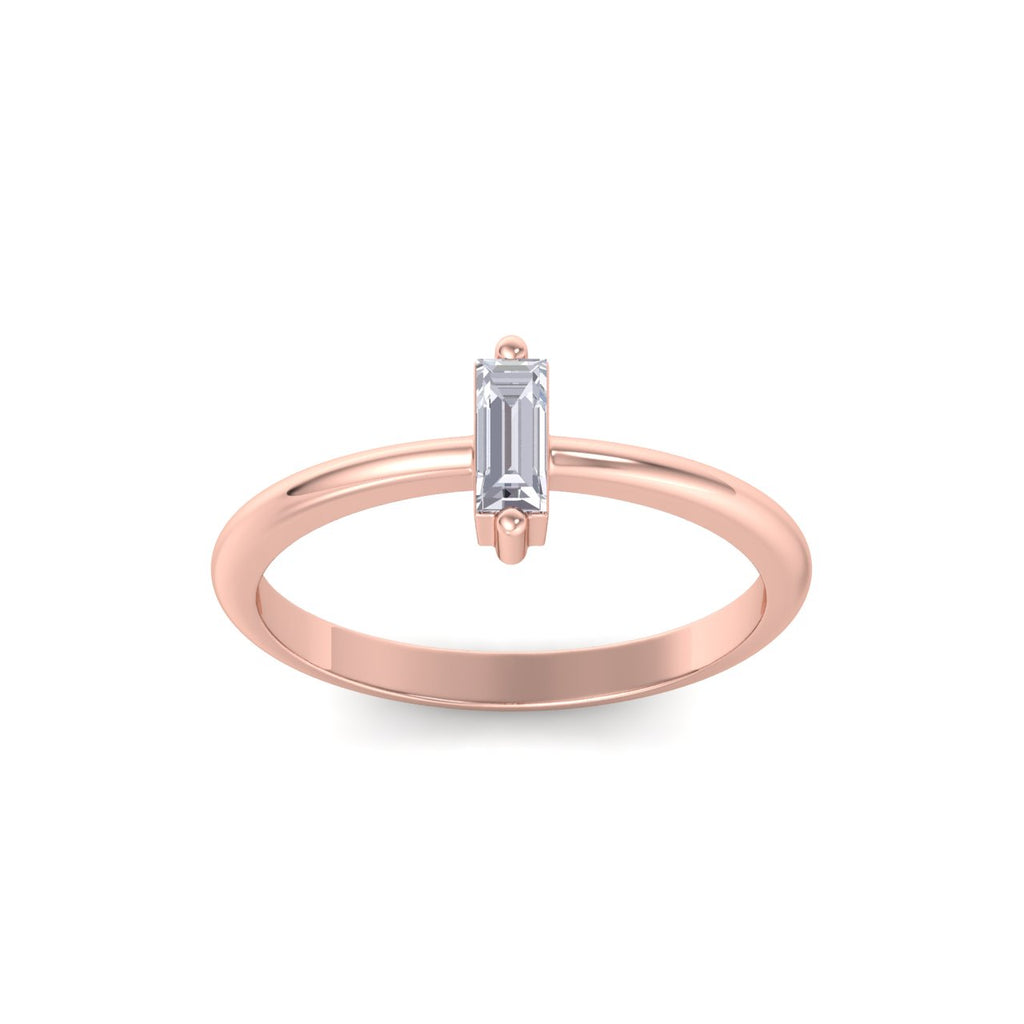 Baguette shaped petite diamond ring in rose gold with white diamonds of 0.25 ct in weight