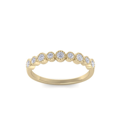 Milgrain wedding band in yellow gold with white diamonds of 0.25 ct in weight