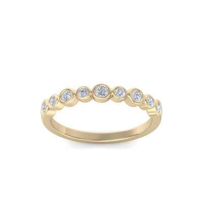 Wedding band in yellow gold with white diamonds of 0.25 ct in weight