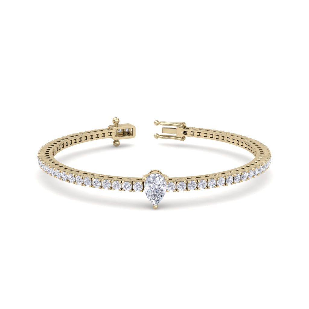 Tennis bracelet with a pear cut center stone in yellow gold with white diamonds of 2.15 ct in weigt