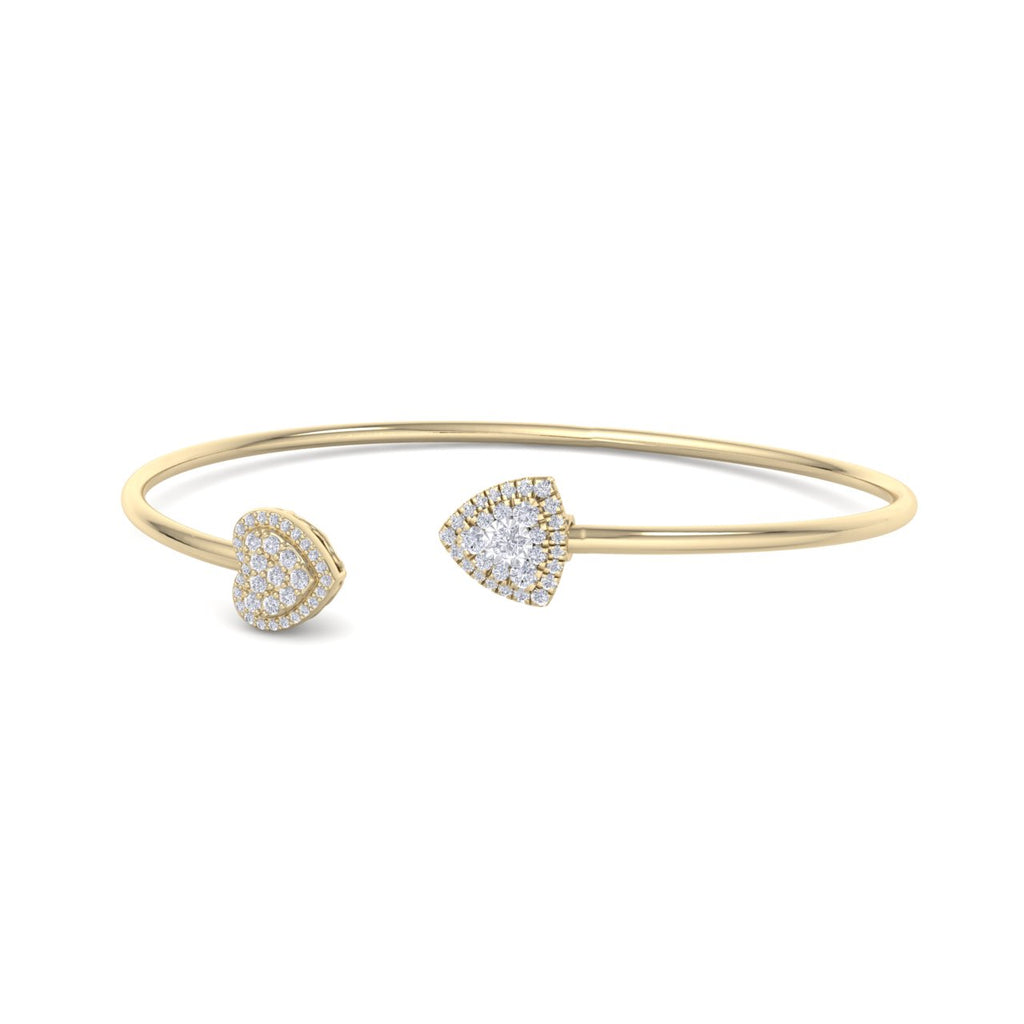Heart shape bangle in yellow gold with white diamonds of 0.42 ct in weight
