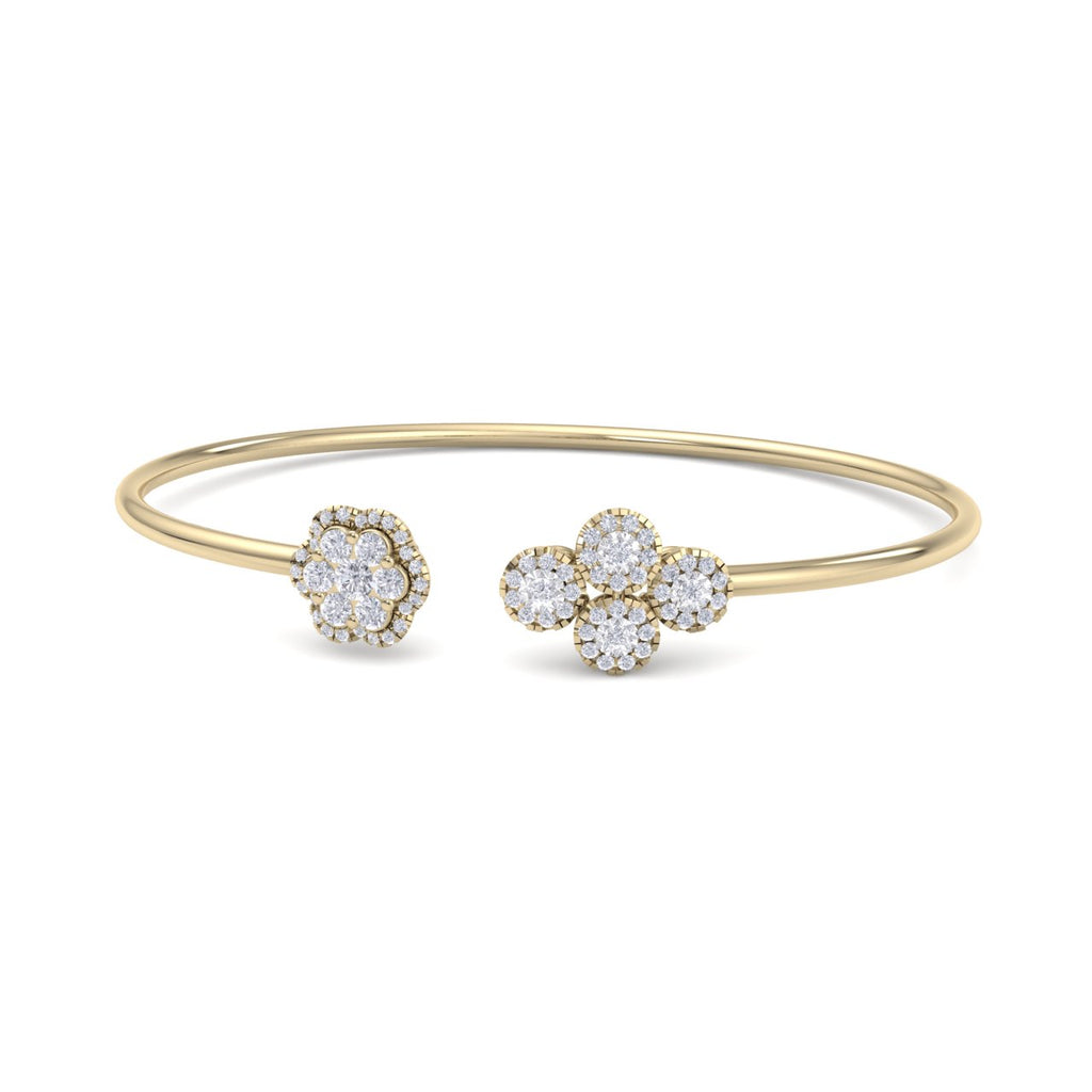 Bangle with flower in yellow gold with white diamonds of 0.69 ct in weight