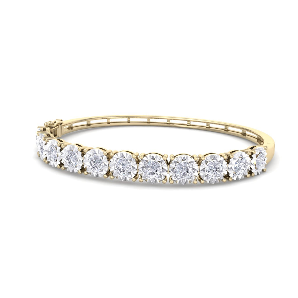 Bangle in yellow gold with white diamonds of 3.30 ct in weight with miracle plate setting