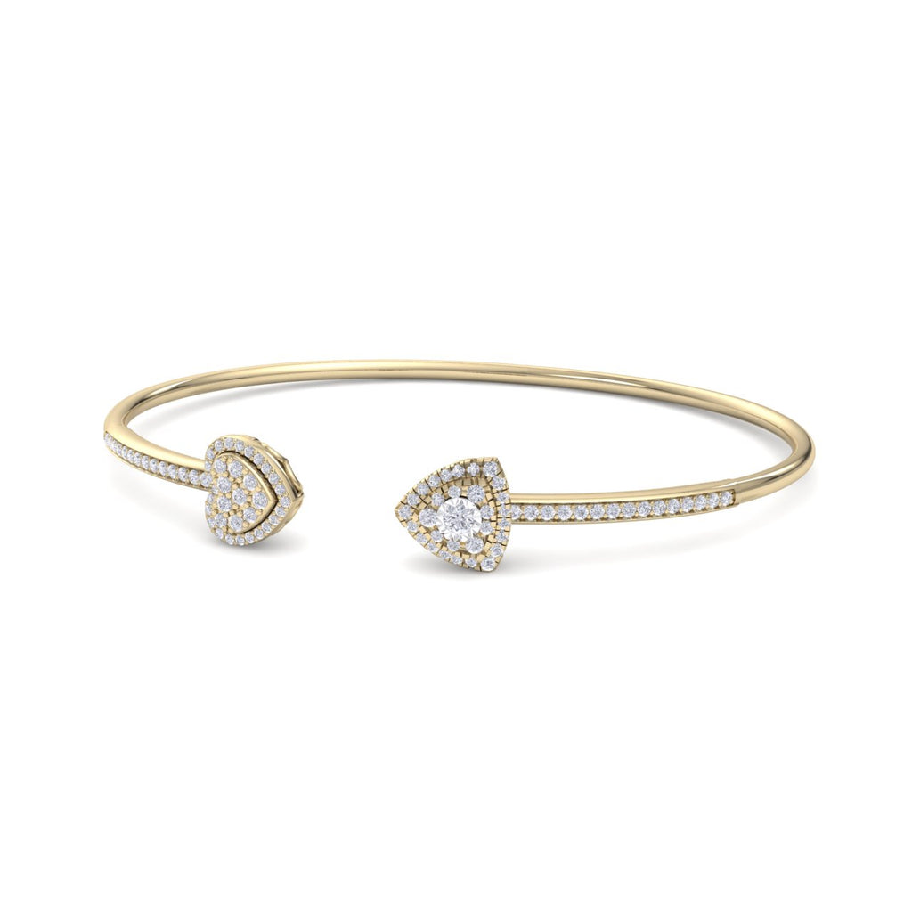 Bangle with heart in yellow gold with white diamonds of 0.56 ct in weight