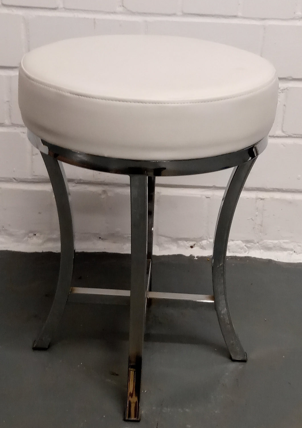 Faux Leather Upholstered Low Round Accent Stool With Metal Legs, White & Chrome - 185728