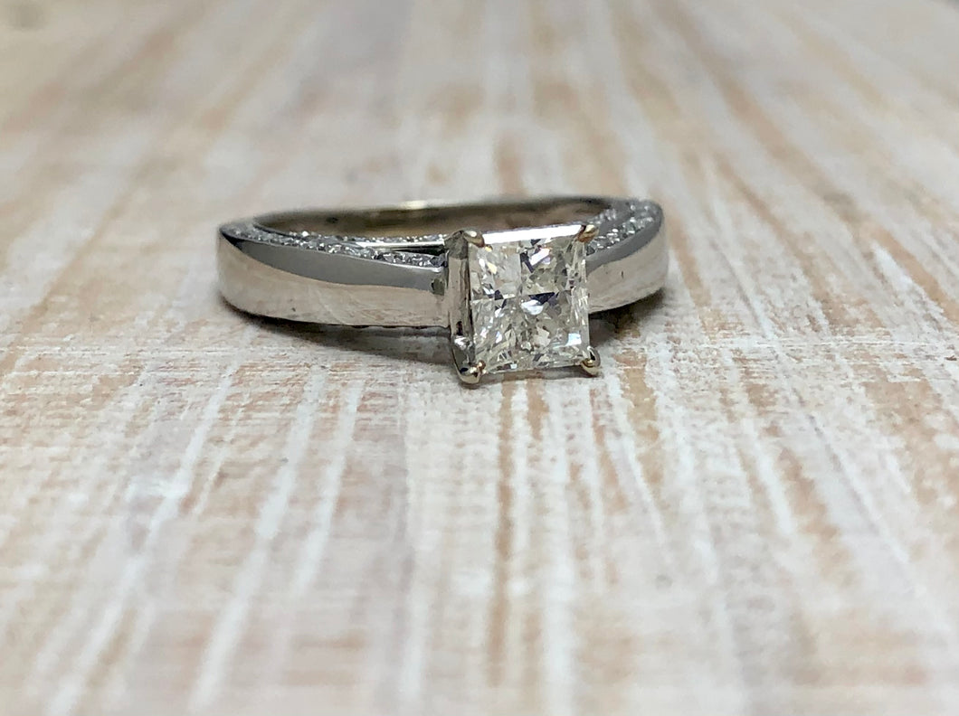 Princess Cut Engagement Ring With Diamonds Embedded In The Cathedral Setting