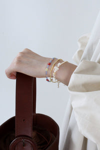 ASYM PEARL BRACELET / YELLOW CREAM