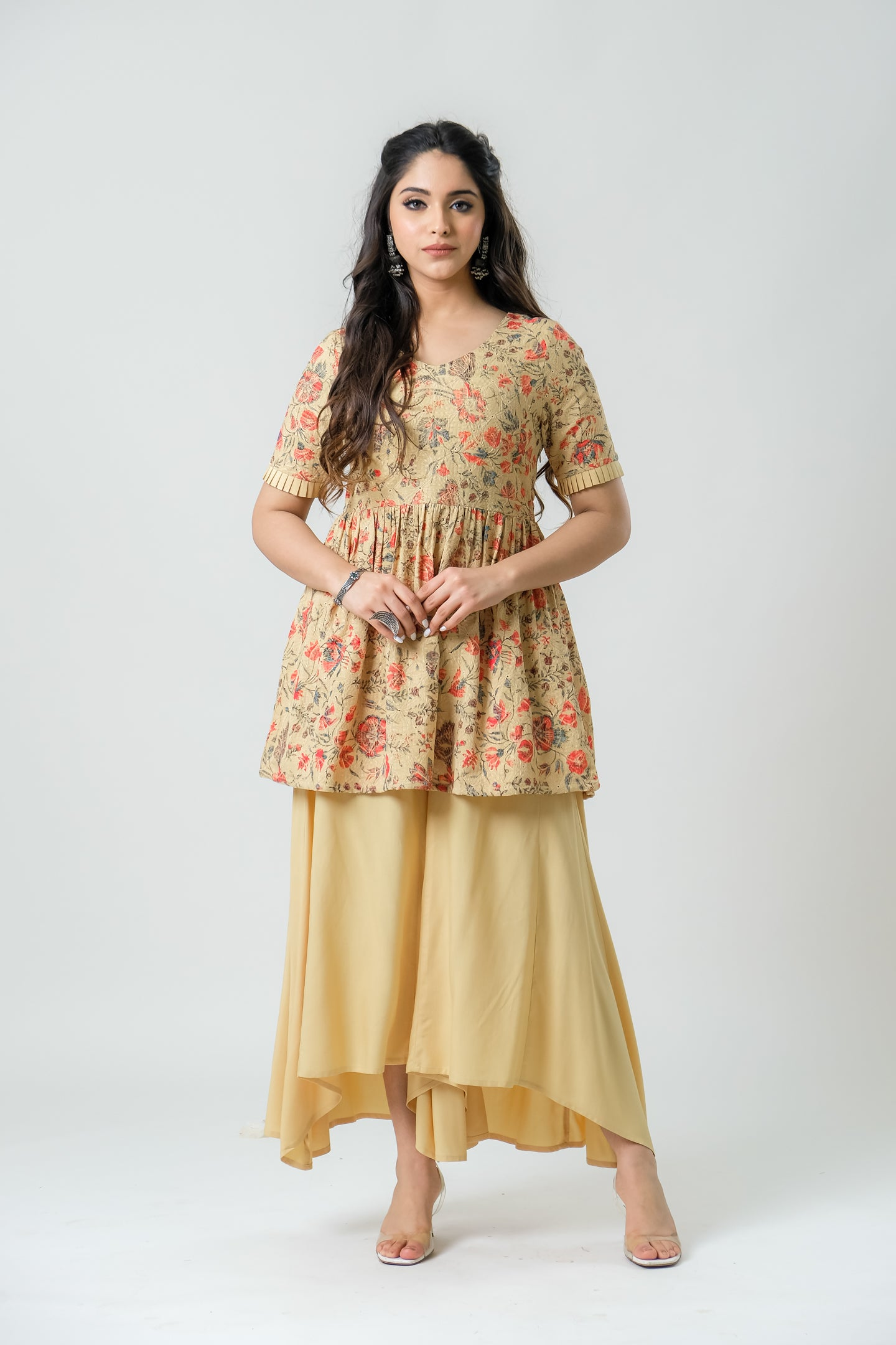 Mustard Printed Peplum Kurti Paired with Flared Pants - Set of 2