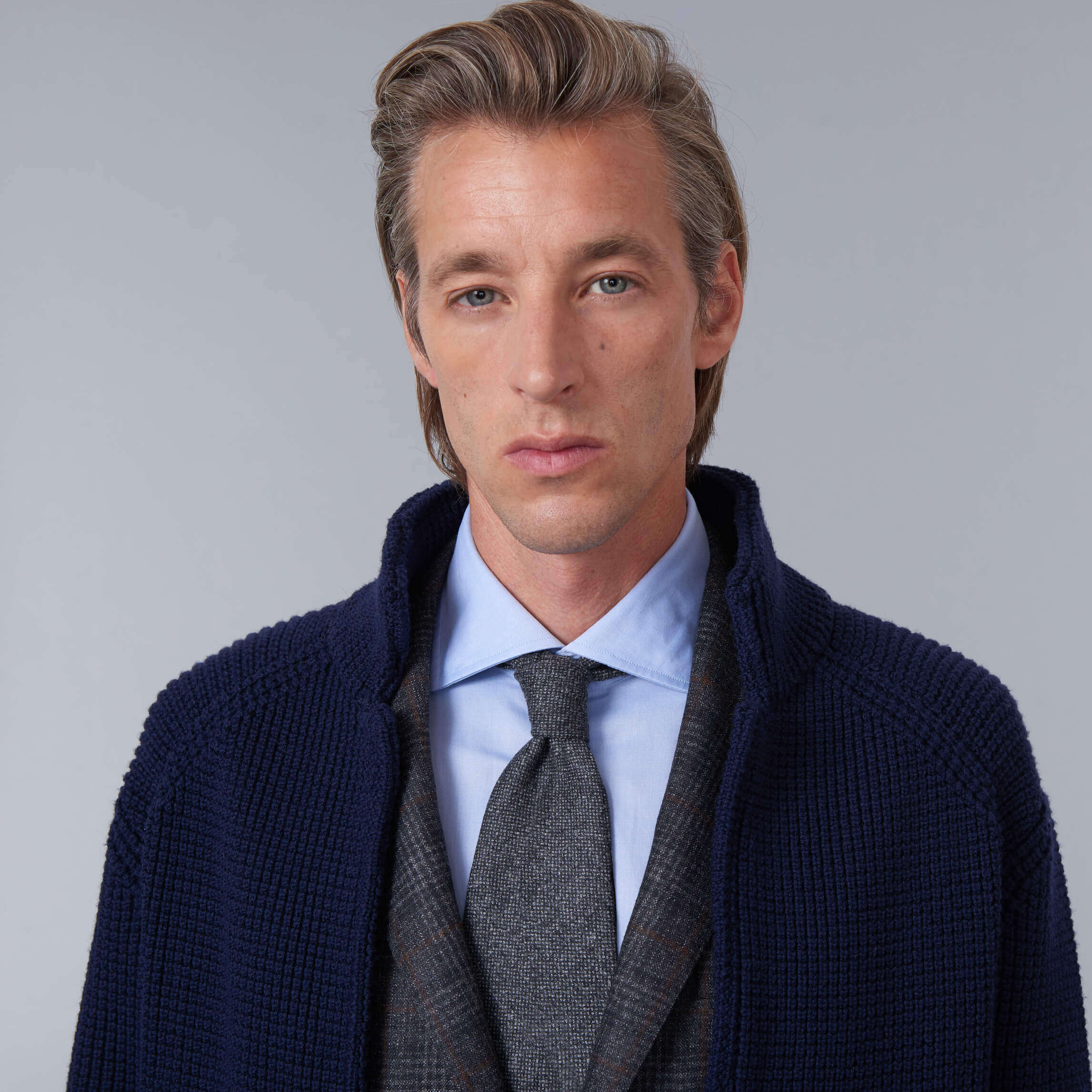 Male model wearing Baldassari knitte jacket in navy