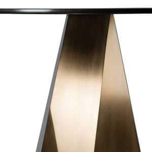 Detail photo of the satin finish of the Jewel Table, asymmetrical geometric table with round blackened steel top and silicon bronze base