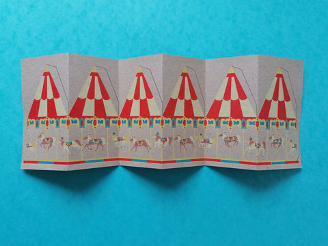 carousel card with tabs drawn on ready to cut, lay flat on a blue background
