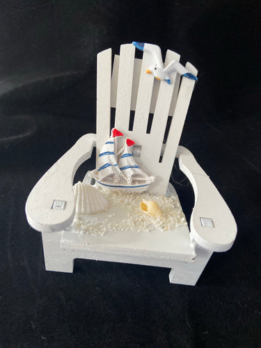 Adirondack chair with sailboat