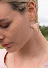 Load image into Gallery viewer, A close up image of our model Emily wearing one of our large copper triangle earrings.  The copper piece hangs from a sterling silver earring hook.