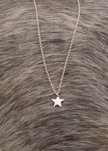Load image into Gallery viewer, A close up image of our silver star pendant, which comprises of a small sterling silver star on a sterling silver chain, which is available in different lengths.