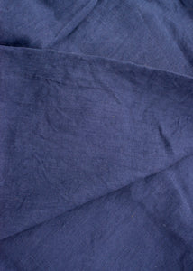 A close up photograph of midnight blue linen.
