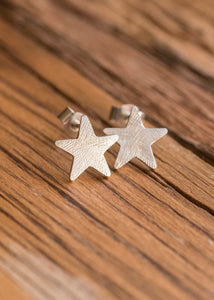 Sterling silver star shaped ear studs with butterfly backs.