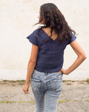 Load image into Gallery viewer, A cap sleeved linen top in midnight blue. There is a v-neck at both back and front, and it is cropped at the waist.