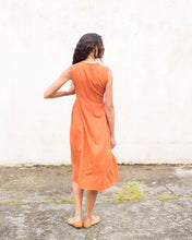 Load image into Gallery viewer, Back view of the burnt orange linen sleeveless dress. This dress is gathered at the waist and is calf-length. It is closed at the back with a salvaged nylon invisible zip.