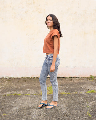 Dark orange linen top with cropped sleeves. This top has a v-neck on both back and front, and is cropped at the waist.