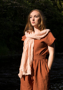 Avocado stone dyed organic cotton scarf in natural blush pink.