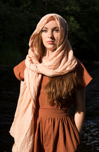 An organic cotton scarf, dyed with avocado stones which produce a subtle pink blush colour.
