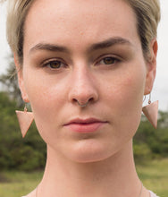 Load image into Gallery viewer, Emily is pictured wearing our copper triangle earrings on sterling silver ear hooks