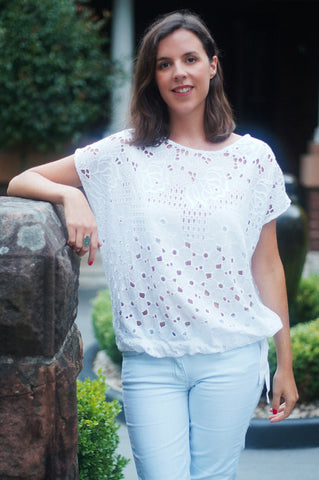 With short cap sleeve this cotton lace top has a draw string at hem